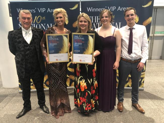 The Craven winners Gemma and William Whitaker, left, with Liz Hird and son David and daughter in law, Ellen