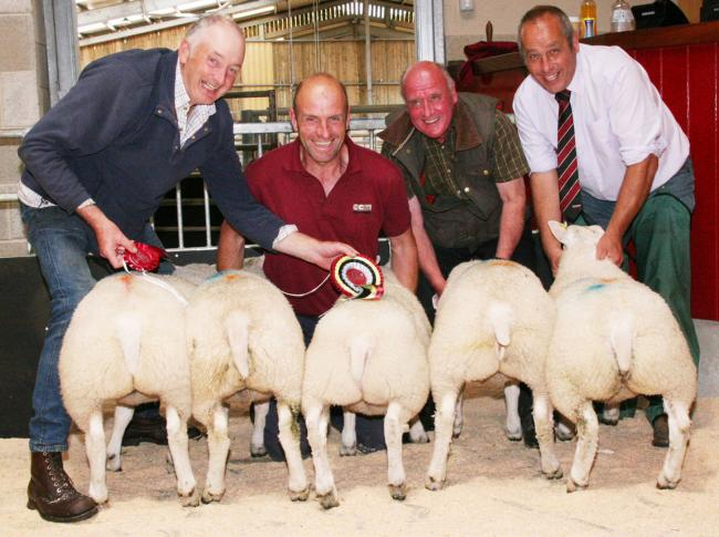 Robert Fielden is pictured left with his Skipton prime lamb champions, joined by helpers, among them judge James Dewhirst, second from right. Picture Moule Media Skipton
