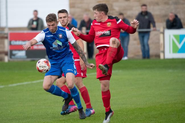 Silsden's Joe Mitchell, right, battles for possession in Silsden's 2-1 defeat to Thackley in their last game. Picture: David Brett