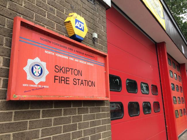 Crews from Skipton fire station freed a man and his dog who had got tangled up in barbed wire