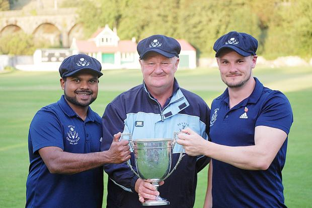 Settle CC pro Ashen Silva, club chairman Andrew Davidson and captain Will Davidson celebrate winning Ribblesdale League trophy. Picture: Gary Chadwick