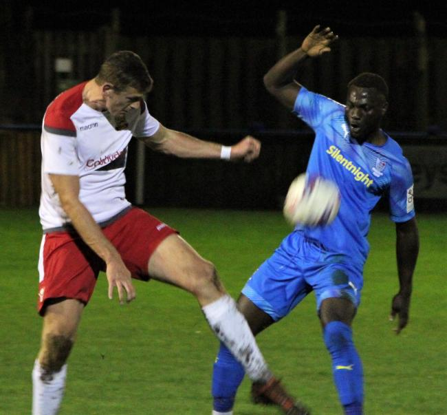 Silsden's Daniel Illingworth and Barnoldswick Town's Sam Amankwaa battle for the ball. Picture: Peter Naylor