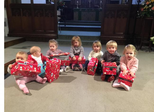 Children from the village's Caterpillar pre-school club with shoeboxes ready for filling