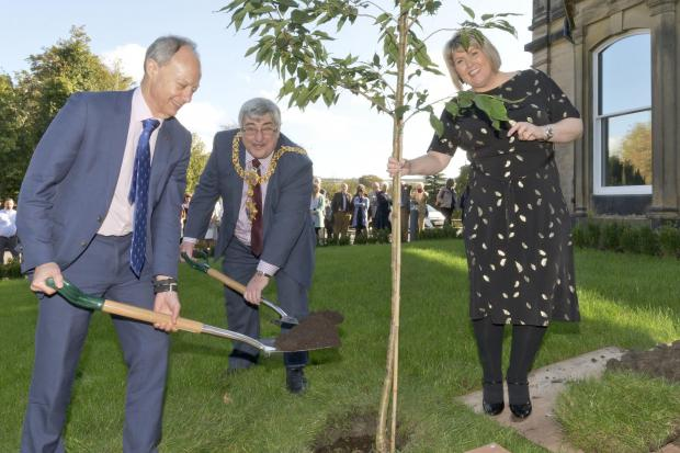 Keighley town mayor Peter Corkindale, centre, digs in with Paul Shevlin, chief executive of Craven Council to plant a tree to commemorate the opening of Malsis Hall in Glusburn, watched by Malsis Hall service director Lisa Gardner