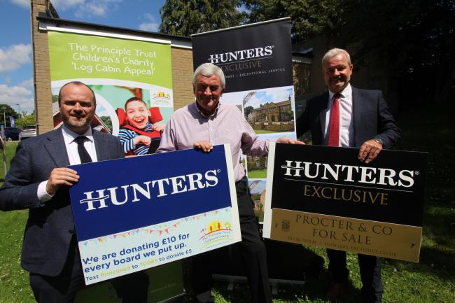 Hunters Estate Agents with the fundraising signs