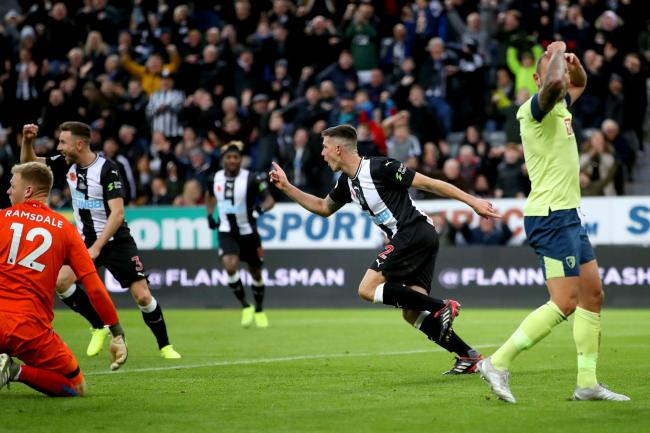 Ciaran Clark (second right) celebrates Newcastle's winner