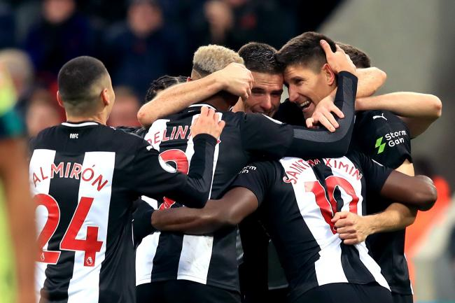 Newcastle defender Ciaran Clark (centre) is congratulated by his team-mates after scoring the winner against Bournemouth