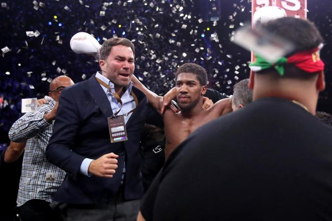 Eddie Hearn (left) said Anthony Joshua had proved his doubters wrong