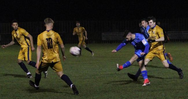 Alex Ralph, who scored for Barnoldswick on Saturday, has a shot at goal against Winsford United last Tuesday. Picture: Peter Naylor