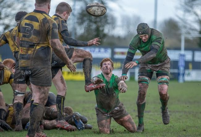Wharfedale's Sam Gaudie battles for the ball in muddy conditions at Hinckley last Saturday. Picture: Ro Burridge