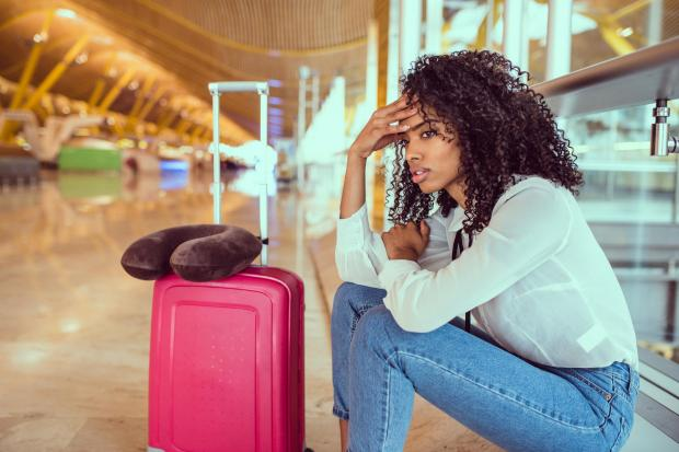 Undated Handout Photo of a woman looking distressed at the airport. See PA Feature TOPICAL Travel Illness. Picture credit should read: PA Photo/iStock. WARNING: This picture must only be used to accompany PA Feature TOPICAL Travel Illness. WARNING: This p