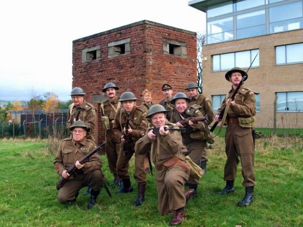 On guard: the Haworth Home Guard re-enactment group in front of the pillbox