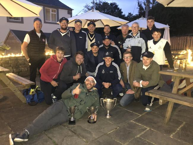 Settle players and members back at Marshfield with the trophies