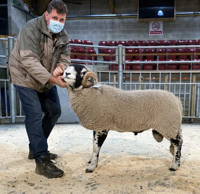 Kevin Huck with his Swaledale ram. Picture Kelly Armitage, CCN