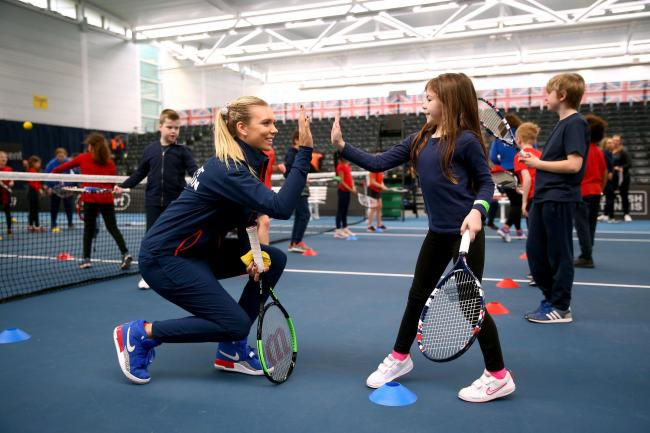 British player Katie Boulter takes part in a Tennis for Kids session