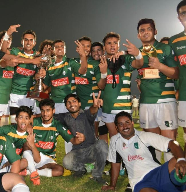 Danyail Ahmed holds the smaller trophy after his brace secured Pakistan a narrow 13-11 win over great rivals India in the U19 Asian Rugby Championship back in 2013.