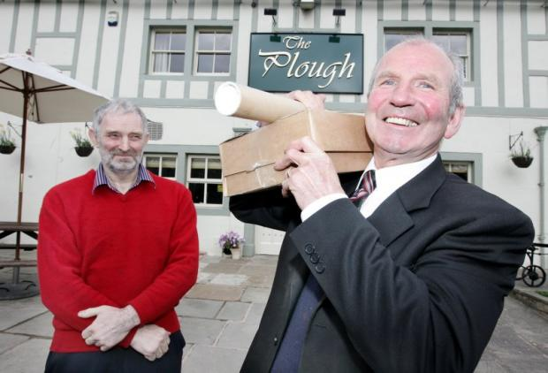MAIL AND ALE: Graham Scruton, front, will run the new post office at The Plough, thanks to publican Philip Walsh, left