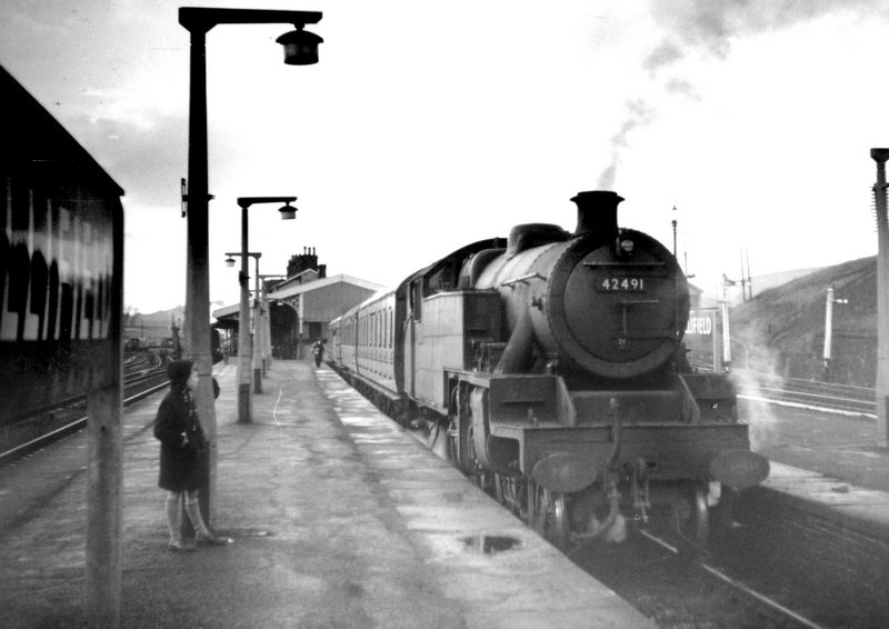 The train to Blackburn, pulled by loco 42491, waiting in the south bay of Hellifield Station in 1962