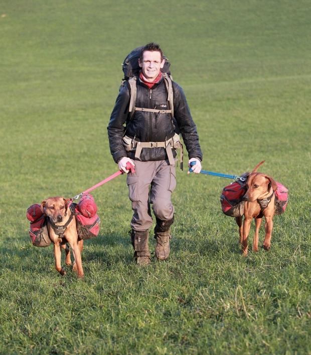 Martin Fletcher and his dogs Jess and Tara preparing for their challenge
