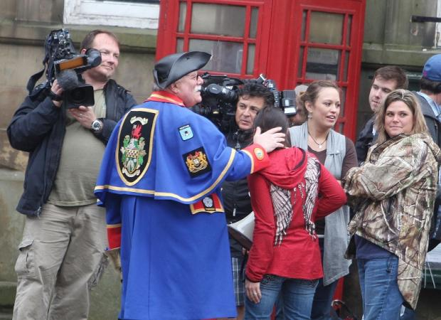 Film crews with the family and town crier Kevin Griffiths in Skipton