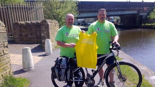 Charity cyclists Nigel Morris (left) and Craig Adams