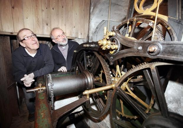 Church-warden Clive Merrill and Rev David Williams viewing the mechanism of the clock
