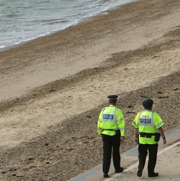A man's body has been found on a beach after he was seen going into the sea
