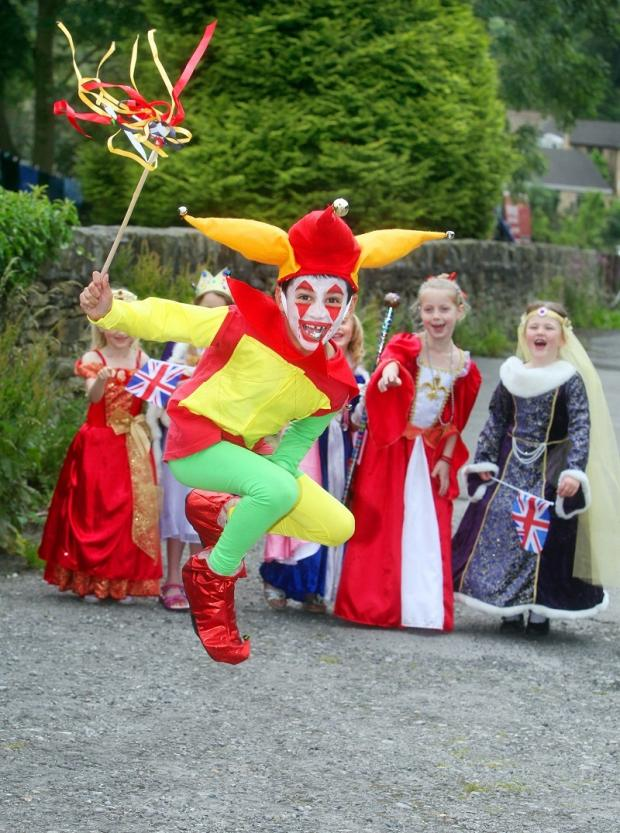 Court Jester Kishan Holdham entertains his classmates from Addingham Primary School