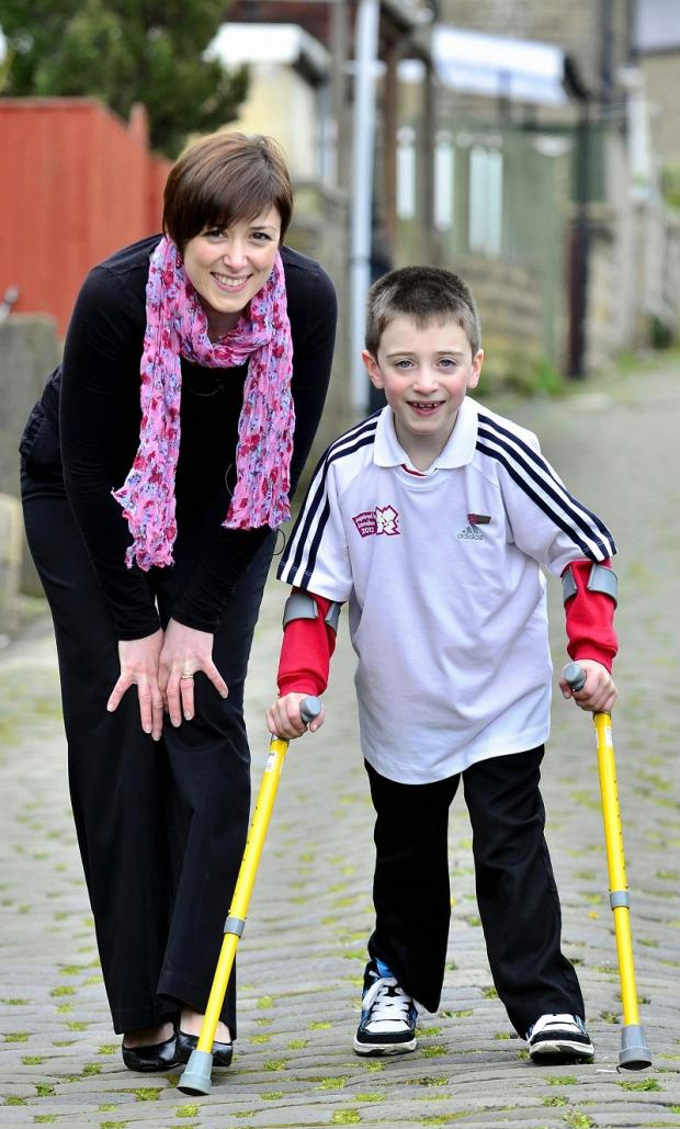 Evan Whitton, with his mum Lynda, when he walked to school for the first time