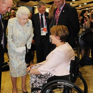 The Queen meets Baroness Grey-Thompson at a reception at the Olympic Stadium
