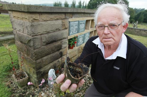 Pendle councillor Morris Horsfield who has spoken out about the incident, at the vandalised grave