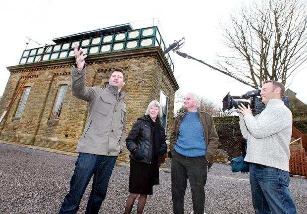 Craven Herald: Mark and Pat Rand, centre, are filmed by Channel Four following their restoration of Settle Water Tower