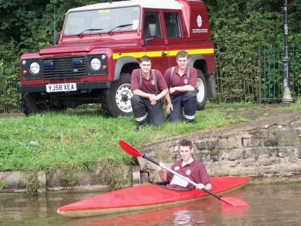 FUNDRAISING: Retained firefighters Jack Smith (front), Mick Langdale and Scott Wild (back, from left) will canoe the full length of the Leeds-Liverpool Canal for charity