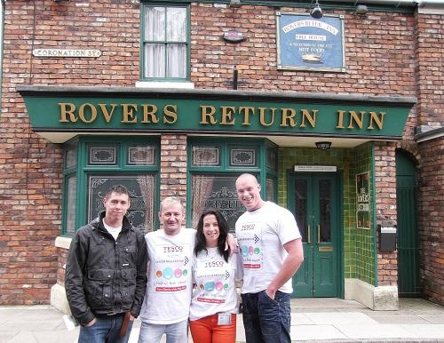 ON THE STREET: Aaron Outhwaite, Keith Moorby, Natalie Belcher, and Damon Ralph outside the Rovers Return on Coronation Street after completing a Lands-End to John O'Groats challenge