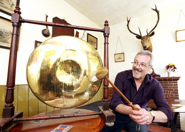 New landlord and former BBC producer Peter Carlton bangs the gong