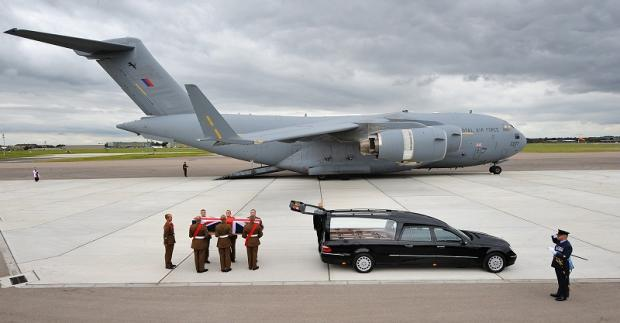 The body of Gareth Thursby is carried from a plane