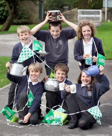 FLAGS OUT: Glusburn Primary School pupils front, Sam Thornton, Daniel Eyles, Ellie Bealey, back Mark Buttherfield, Mitchell Hardaker and Mollie Smith