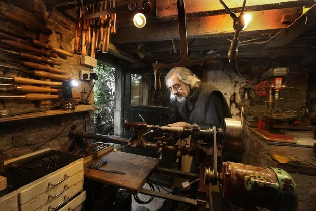 Former blacksmith Kerry Burns, pictured in his workshop, is asking for tools to send to Africa