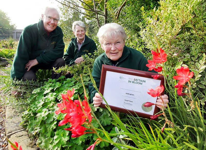 Addingham Garden Friends members Graham Bacon, Fiona Watson and Carol Miles celebrate the silver gilt award