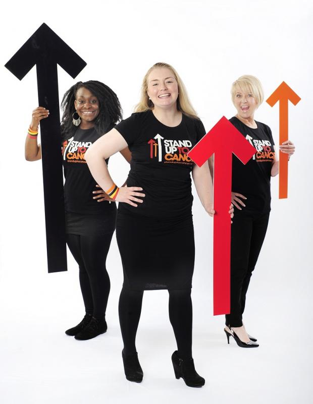 Cancer Research UK fundraiser Natasha Howe, centre, Stands Up to Cancer, joined by colleagues Chloé Williams, left, and Carole Avery
