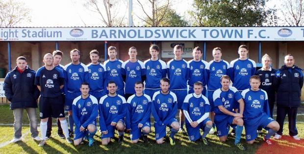 Barnoldswick Town try out the warm-up tops given to them by Everton