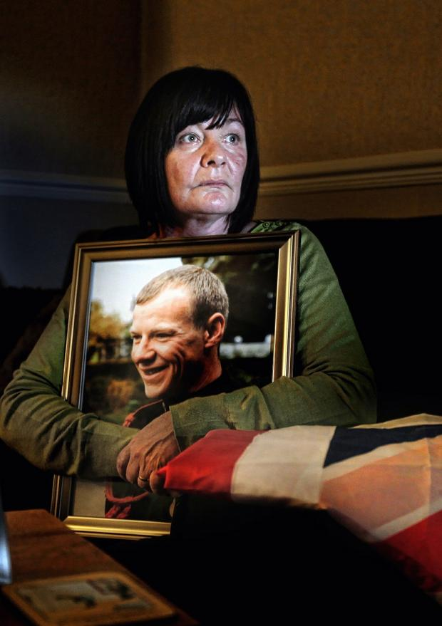 Caroline Whitaker, the mother of fallen soldier Gareth Thursby clutches a portrait of her son