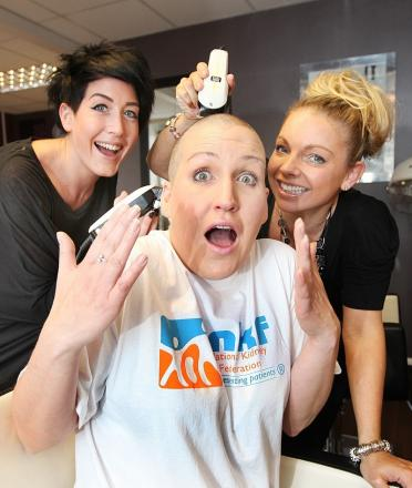 Emma Appleton has her head shaved by Laura Broadbent and Marie Clough