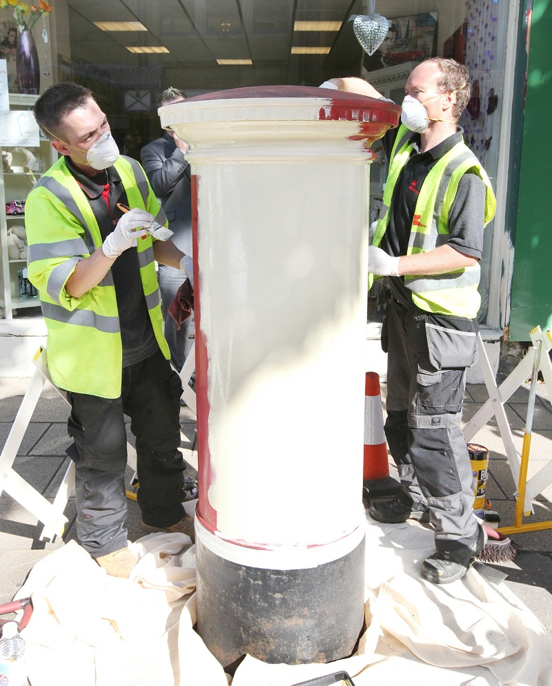 The post box in Skipton being painted gold earlier this year