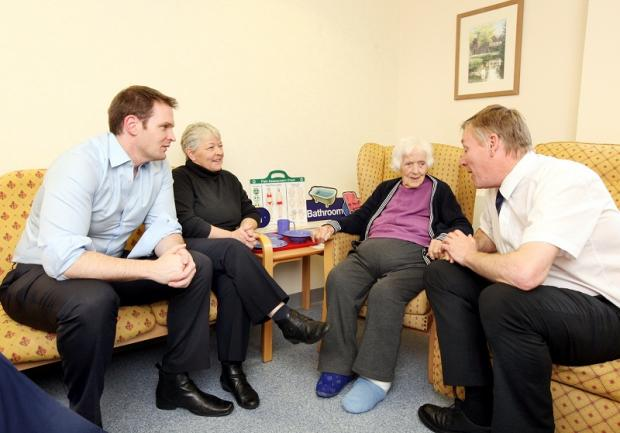 Dan Poulter talking to Joan Harrison, patient Hannah Moorby and local MP Kris Hopkins during a visit to Airedale Hospital