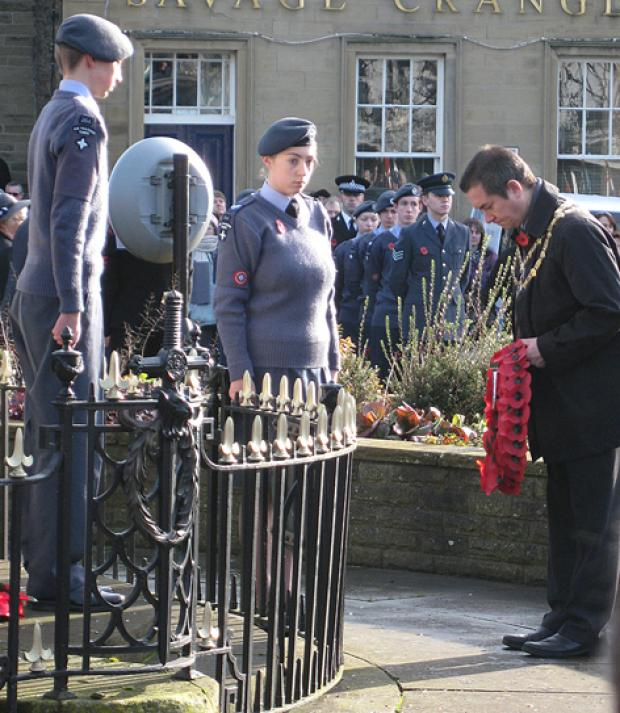 Craven District Council chairman Chris Harbron lays a wreath at Skipton War Memorial