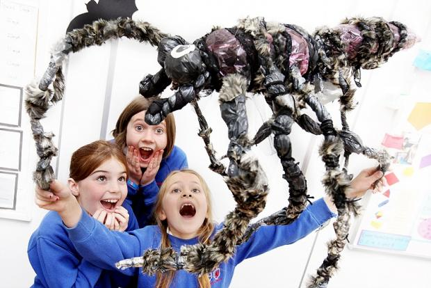 Molly Whitehead, Sophie Evans and Mary Allen get to grips with the giant spider in their maths lessons