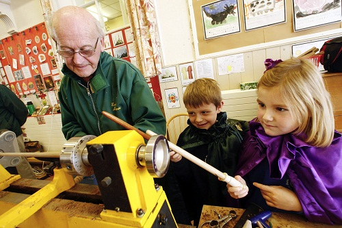 Aire View Infants School pupils James Isherwood, five, and Jessica Eakin, six, watch the magic of woodturning with Eric Mann of the Outer Turning Circle