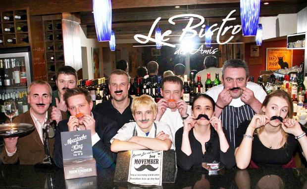 Le Bistro des Amis staff show off their taches