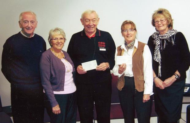 From left are Martin Wilkinson, Edna Atkinson, Tony Doveston, from Yorkshire air ambulance, Mary Miller, secretary of Kelbrook Village Hall and Jackie Barker.